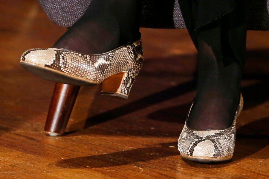 Supreme Court Justice Ruth Bader Ginsburg sports fashionable shoes as she speaks with author Jeffrey Rosen at the National Constitution Center Americas Town Hall at the National Museum of Women in the Arts, in 2019. (AP Photo/Steve Helber)