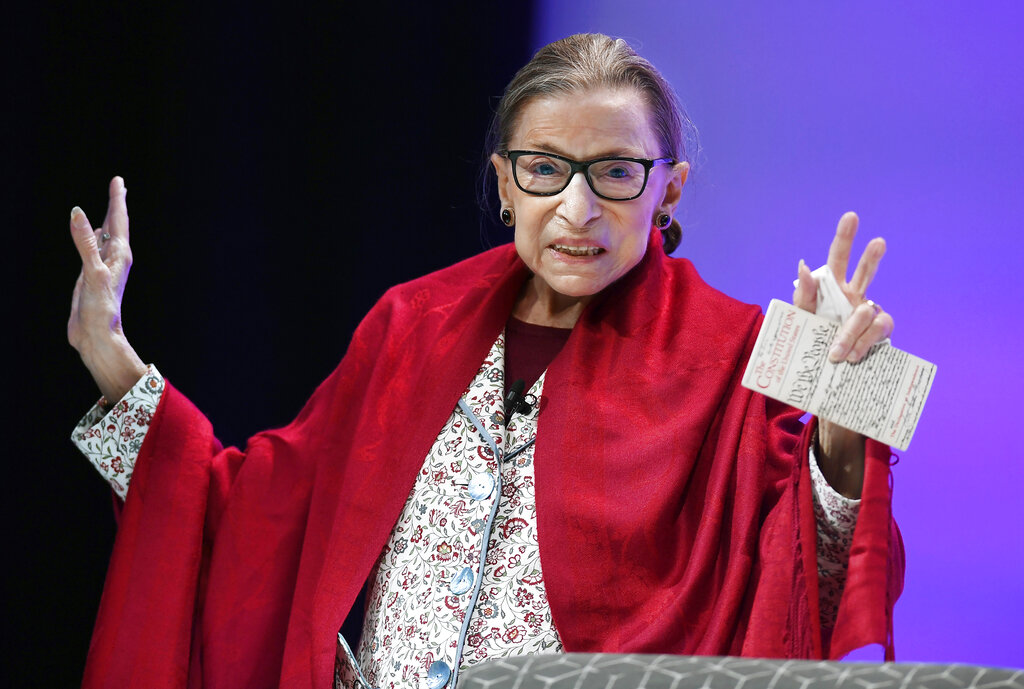 U.S. Supreme Court Justice Ruth Bader Ginsburg gestures to students before she speaks at Amherst College in Amherst, Mass. in 2019. (AP Photo/Jessica Hill)