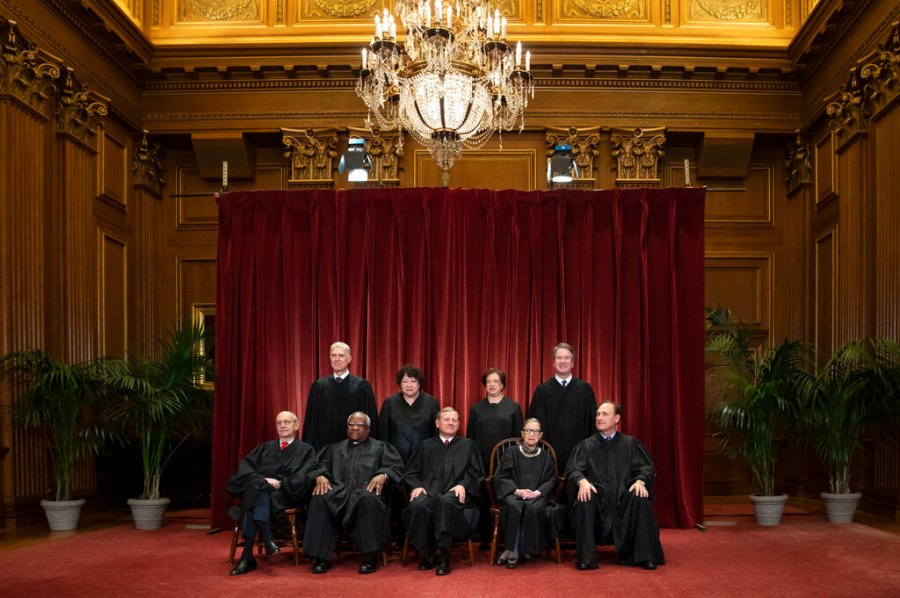 The justices of the U.S. Supreme Court gather for a formal group portrait in 2018. Seated from left: Associate Justice Stephen Breyer, Associate Justice Clarence Thomas, Chief Justice of the United States John G. Roberts, Associate Justice Ruth Bader Ginsburg and Associate Justice Samuel Alito Jr. Standing behind from left: Associate Justice Neil Gorsuch, Associate Justice Sonia Sotomayor, Associate Justice Elena Kagan and Associate Justice Brett M. Kavanaugh. (AP Photo/J. Scott Applewhite, File)