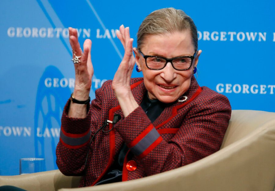 Supreme Court Justice Ruth Bader Ginsburg applauds after a performance in her honor after she spoke about her life and work during a discussion at Georgetown Law School in Washington. (AP Photo/Alex Brandon, File)