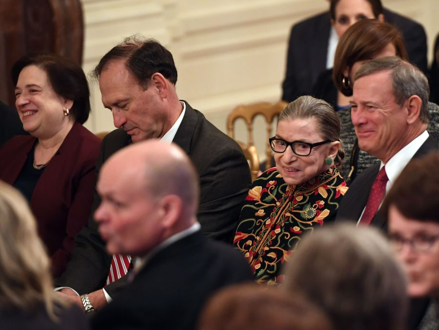 US Supreme Court Justices (L-R) Elena Kagan, Samuel Alito, Ruth Bader Ginsburg and Chief Justice John Roberts attend the Presidential Medal of Freedom ceremony at the White House in Washington, DC, on November 16, 2018. - The Medal is the highest civilian award of the United States. (Photo credit should read SAUL LOEB/AFP via Getty Images)