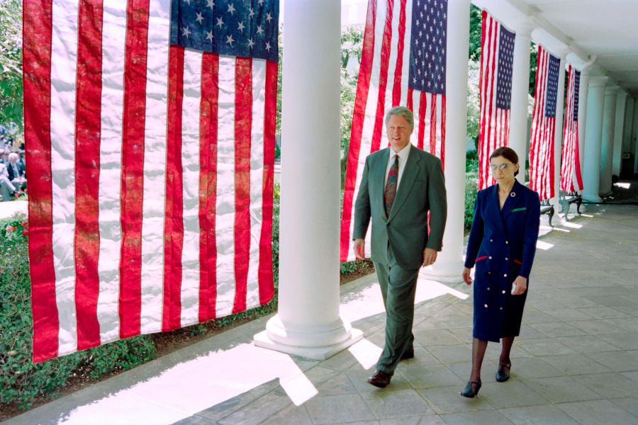 President Bill Clinton walks with Judge Ruth Bader Ginsburg on the way to a press conference at the White House in 1993. Clinton announced the selection of Judge Ginsburg to succeed Judge Byron White as US Supreme Court Justice. (Photo credit should read DAVID AKE/AFP via Getty Images)