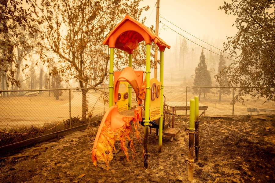 A melted slide smolders as a playground continues to burn at Pine Ridge school during the Creek Fire. W(Photo by JOSH EDELSON/AFP via Getty Images)
