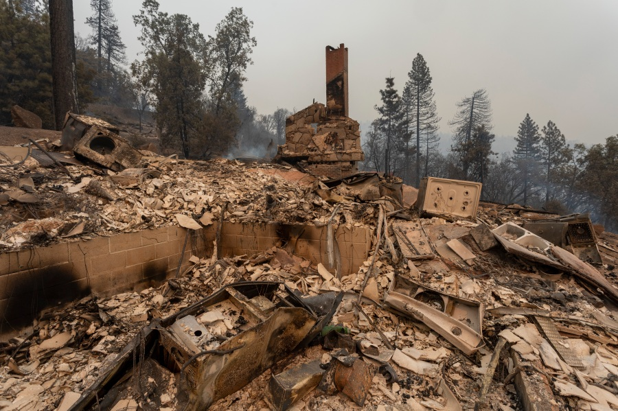 A home is completely destroyed after the Creek Fire swept through the area near Shaver Lake, California. California Gov. Gavin Newsom has declared a state of emergency in five California counties after record heatwave temperatures fueled numerous wildfires over the Labor Day weekend. The state of emergency applies to Fresno, Madera and Mariposa, San Bernardino and San Diego counties.  (Photo by David McNew/Getty Images)