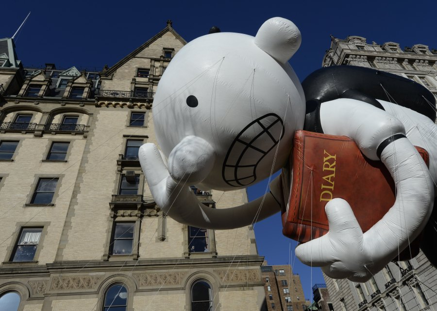 The Diary of a Wimpy Kid balloon makes its way down Central Park West during the 87th Macy's Thanksgiving Day Parade in 2013. (Photo credit should read TIMOTHY CLARY/AFP via Getty Images)