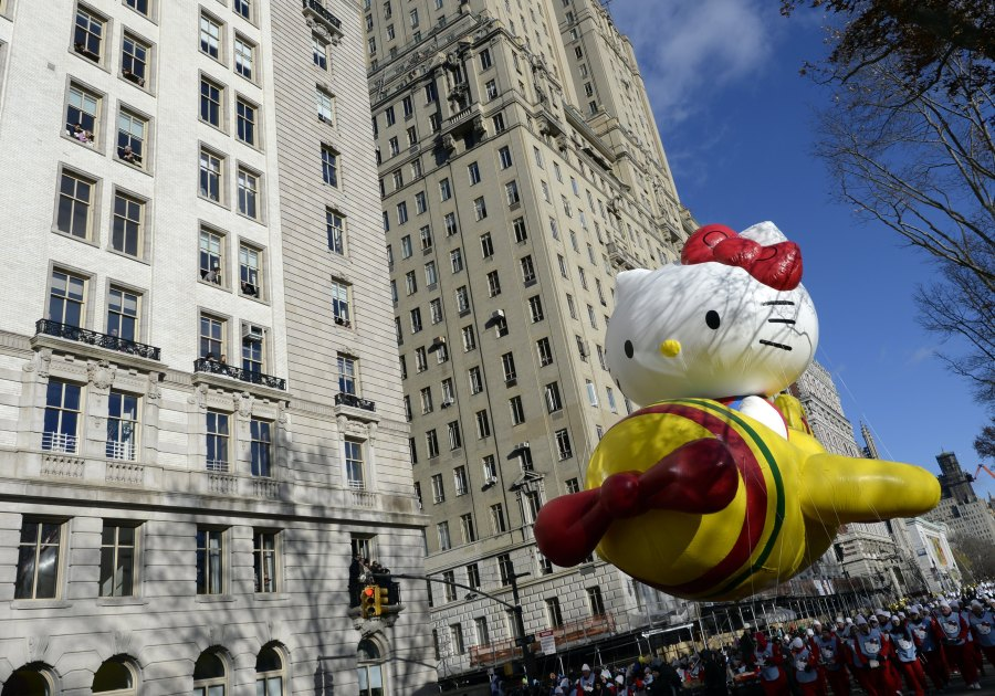 The Hello Kitty balloon floats down Central Park West during the 87th Macy's Thanksgiving Day Parade in 2013. (Photo credit should read TIMOTHY CLARY/AFP via Getty Images)