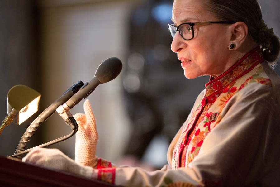 U.S. Supreme Court Justice Ruth Bader Ginsburg speaks at an annual Women's History Month reception hosted by House Speaker Nancy Pelosi in the U.S. capitol building in Washington, D.C.  This year's event honored the women Justices of the U.S. Supreme Court: Associate Justices Ruth Bader Ginsburg, Sonia Sotomayor, and Elena Kagan. (Photo by Allison Shelley/Getty Images)