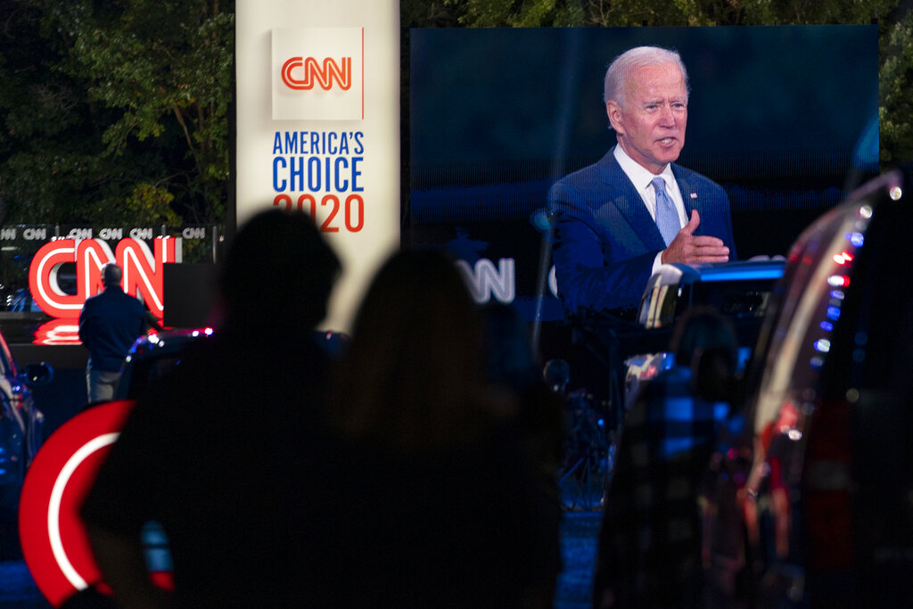 Audience members watch from their cars as former Vice President Joe Biden speaks during a CNN town hall in Moosic, Pa., on Thursday. (AP Photo/Carolyn Kaster)