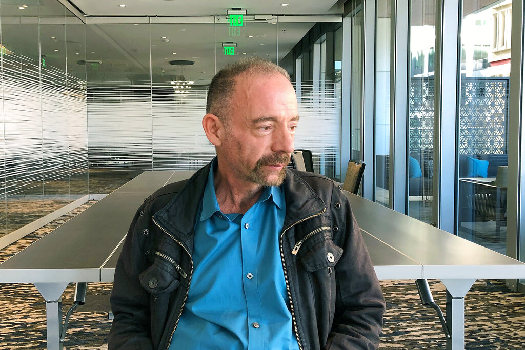 Timothy Ray Brown poses for a portrait in Seattle in 2019. Brown, an American who was known for years as the Berlin patient, had a transplant in Germany from a donor with natural resistance to the AIDS virus. It was thought to have cured Brown's leukemia and HIV. But in an interview Thursday, Brown said his cancer returned last year and has spread widely. His case has inspired scientists to seek more practical ways to try to cure the disease. (AP Photo/Manuel Valdes)
