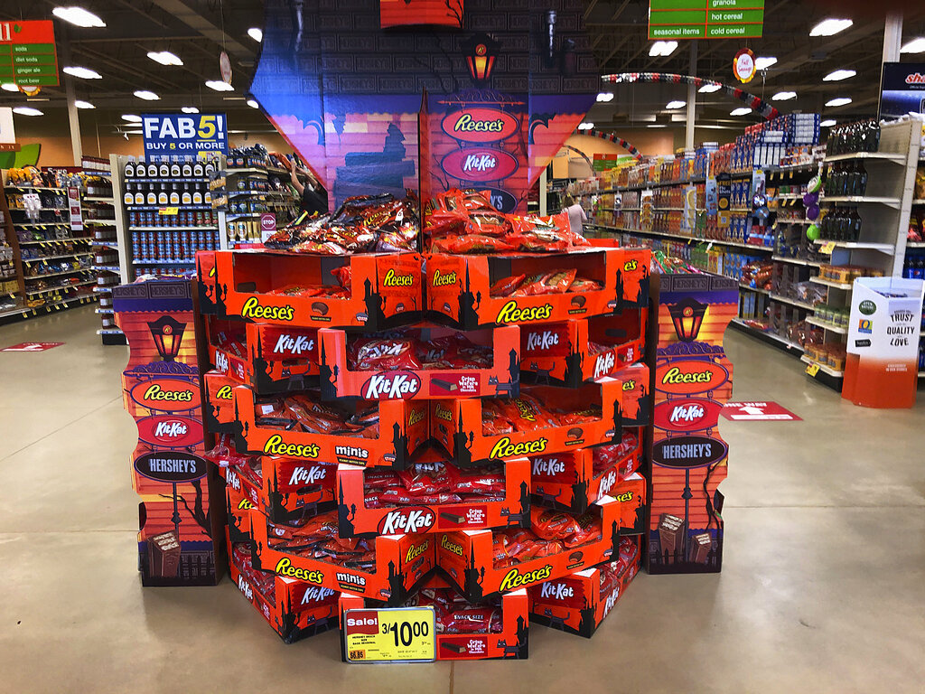 Halloween candy displayed at a store in Freeport, Maine. Earlier Halloween displays at some chains stores likely helped boost sales. But Americans may also be in a mood to celebrate after months of pandemic anxiety. (AP Photo/Robert F. Bukaty)