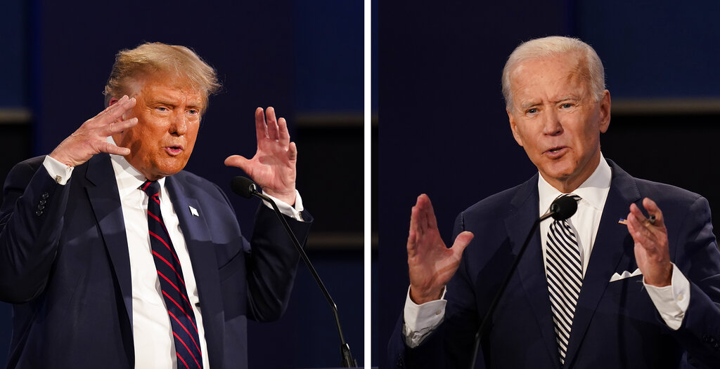 President Donald Trump and former Vice President Joe Biden during the first presidential debate at Case Western University and Cleveland Clinic, in Cleveland, Ohio. (AP Photo/Patrick Semansky)