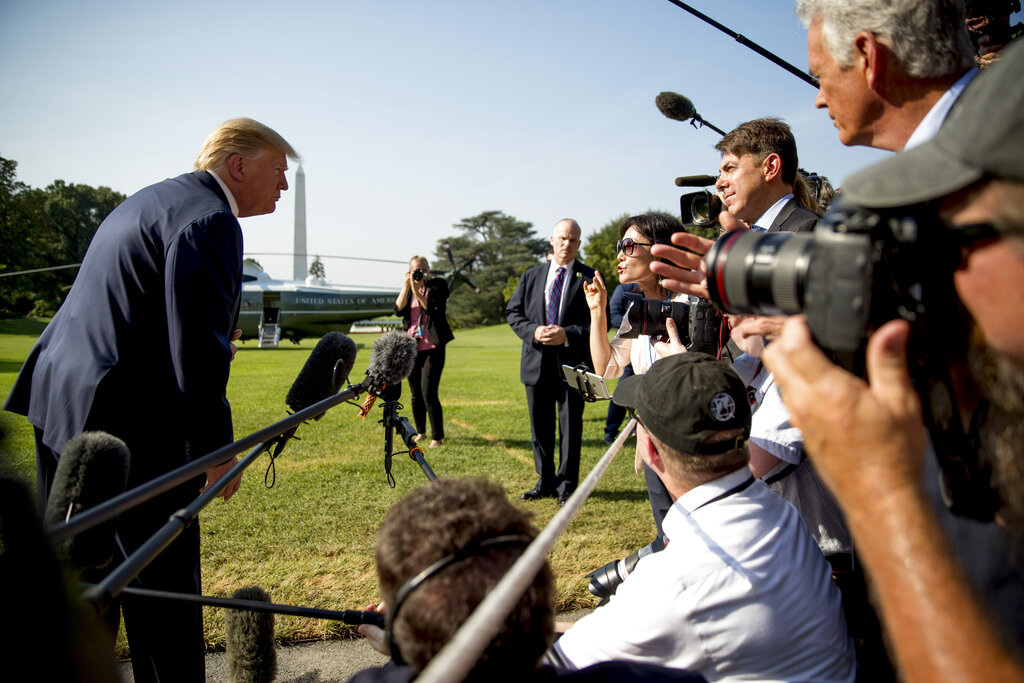 President Trump takes a question from a member of the media on the South Lawn of the White House in Washington before boarding Marine One. On Friday, Sept. 11, 2020, The Associated Press reported on a video circulating online incorrectly depicting Trump lost and meandering around the White House lawn. The original Aug. 7, 2019 video clip, available on C-SPAN, was edited to make it appear the president is experiencing dementia symptoms ahead of the election. (AP Photo/Andrew Harnik)