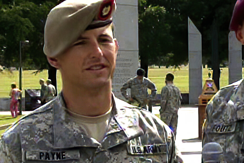 In this image from video provided by the U.S. Army, then-Sgt. 1st Class Thomas Payne is interviewed after winning the 2012 Best Ranger competition at Fort Benning, Ga. Payne will receive the Medal of Honor, the U.S. military's highest honor for valor in combat, for actions during a daring 2015 raid in Iraq that rescued about 70 hostages who were set to be executed by ISIS militants. Sgt. Maj. Payne will receive the honor in a White House ceremony on the 19th anniversary of the Sept. 11, 2001, terrorist attacks. (Lori Egan/U.S., Army via AP)