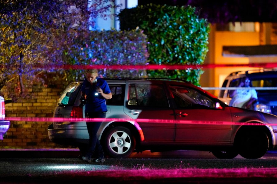 "An investigator works the scene where a man suspected of fatally shooting a supporter of a right-wing group in Portland, Ore., last week was killed as investigators moved in to arrest him in Lacey, Wash. Michael Reinoehl, 48, was killed as a federal task force attempted to apprehend him in Lacey, a senior Justice Department official said. Reinoehl was the prime suspect in the killing of 39-year-old Aaron ""Jay"" Danielson, who was shot in the chest Saturday night, the official said. (AP Photo/Ted Warren)"