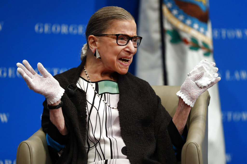 U.S. Supreme Court Justice Ruth Bader Ginsburg reacts to applause as she is introduced by William Treanor, Dean and Executive Vice President of Georgetown University Law Center, at the Georgetown University Law Center campus in Washington in 2017. On Friday,, The Associated Press reported on stories circulating online incorrectly claiming Ginsburg wanted to lower the age of consent for sex to 12 years old. This bogus claim first emerged during Ginsburg's 1993 confirmation hearings when official testimony misinterpreted a recommendation by Ginsburg in a 1977 report published by the United States Commission on Civil Rights. (AP Photo/Carolyn Kaster, File)