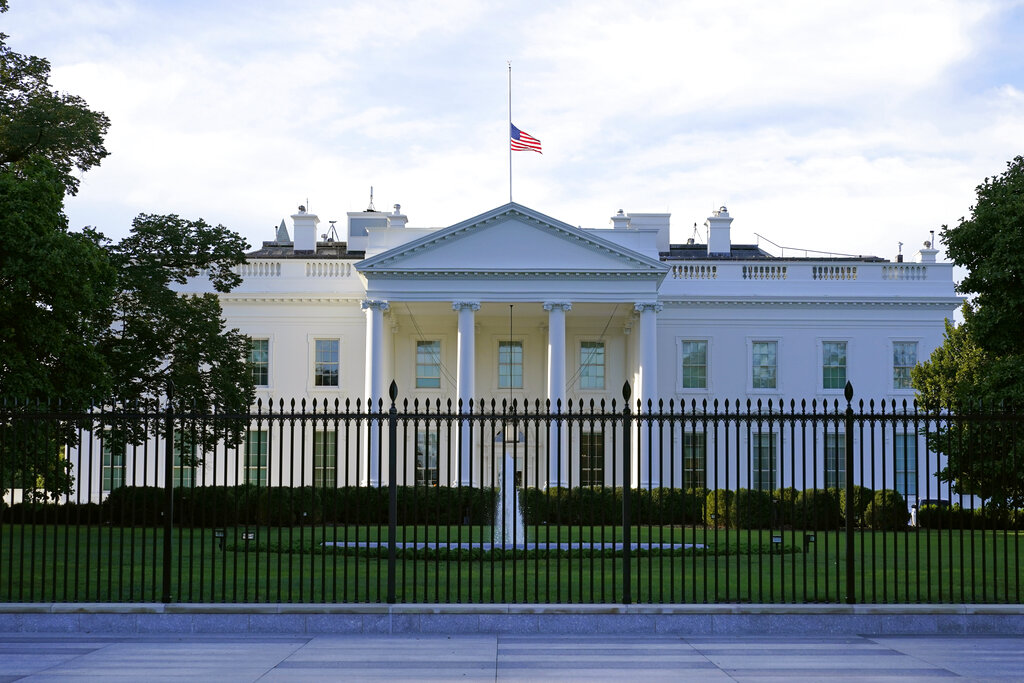 The American flag flies at half-staff over the White House in Washington. A woman suspected of sending an envelope containing the poison ricin, which was addressed to White House, has been arrested at the New York-Canada border. (AP Photo/Patrick Semansky, File)