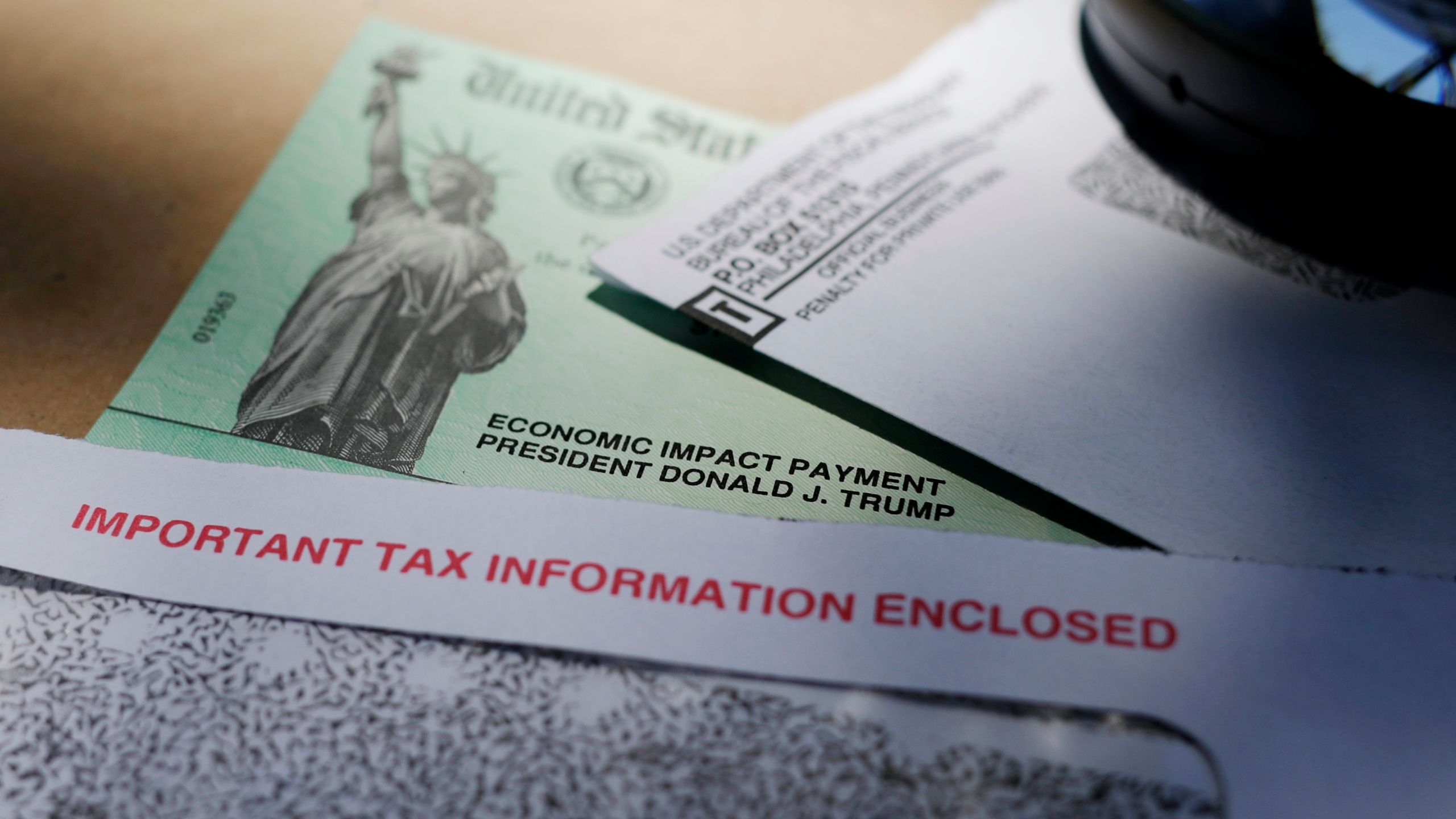 President Donald Trump's name is seen on a stimulus check issued by the IRS to help combat the adverse economic effects of the COVID-19 outbreak. There were just a few hundred coronavirus cases when Congress first started focusing on emergency spending in early March. By the end of that month, as Congress passed the massive $2.2 trillion Cares Act, cases skyrocketed above 100,000 and deaths climbed past 2,000. (AP Photo/Eric Gay, File)