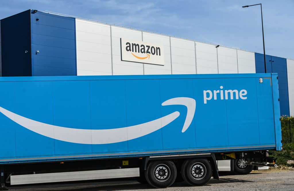 An Amazon delivery truck is parked outside the Amazon logistics centre in Lauwin-Planque, northern France. (Photo by DENIS CHARLET/AFP via Getty Images)
