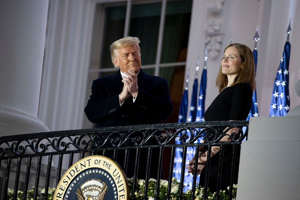 President Trump stands with newly sworn in U.S. Supreme Court Associate Justice Amy Coney Barrett during a ceremonial swearing-in event on the South Lawn of the White House October 26, 2020 in Washington, DC. The Senate confirmed Barrett's nomination to the Supreme Court today by a vote of 52-48. (Photo by Tasos Katopodis/Getty Images)