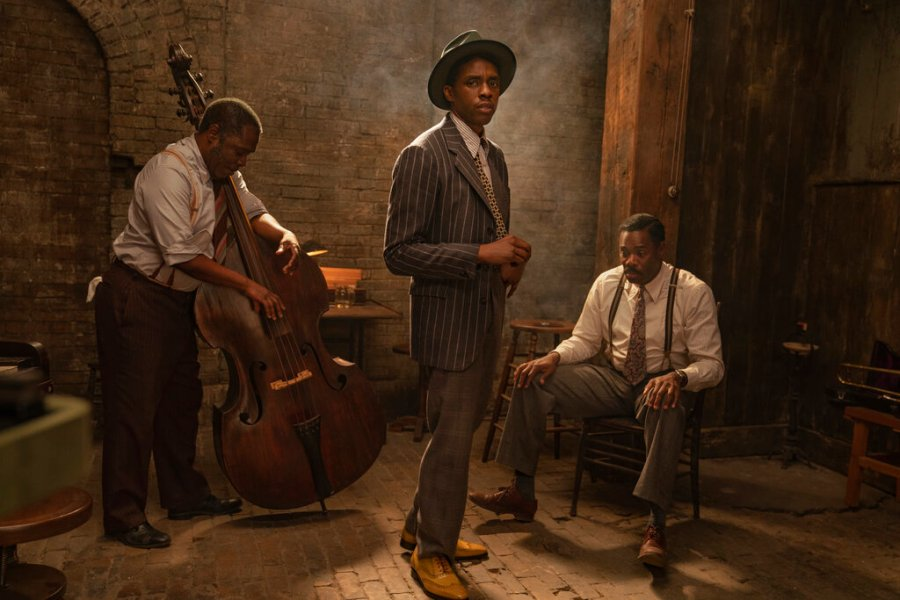 "This image released by Netflix shows from left, Michael Potts, Chadwick Boseman and Colman Domingo in ""Ma Rainey's Black Bottom."" Netflix on Monday previewed George C. Wolfe's August Wilson adaptation ""Ma Rainey's Black Bottom,"" showcasing Chadwick Boseman's final performance opposite Viola Davis' powerhouse blues singer. (David Lee/Netflix via AP)"