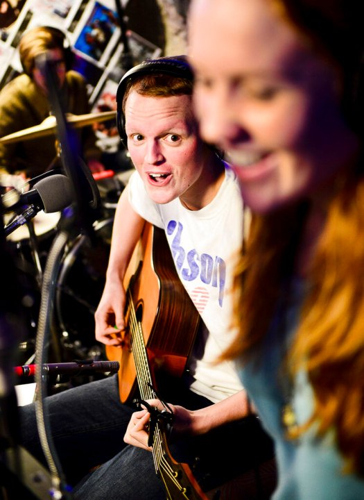 "Zach Sobiech, left, plays guitar as his friend Samantha ""Sammy"" Brown, foreground, sings a song they wrote earlier that night called ""Star Hopping"" in Lakeland, Minn. in 2012. Seven years after his death from cancer at age 18, the Minnesota singer-songwriter has returned to the top of the iTunes chart with his inspirational tune ""Clouds."" The Star Tribune reports that ""Clouds"" by Sobiech took over iTunes' No. 1 slot from Justin Bieber on Sunday, two days after the Hollywood movie of the same name based on Sobiech's life premiered on Disney+. (Ben Garvin/Pioneer Press via AP, File)"