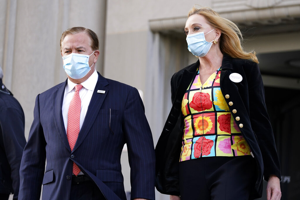 Mark and Patricia McCloskey leave a court hearing Wednesday in St. Louis. The McCloskeys have pleaded not guilty to two felony charges, unlawful use of a weapon and tampering with evidence, after been seen waving guns at protesters marching on their private street this past summer. (AP Photo/Jeff Roberson)