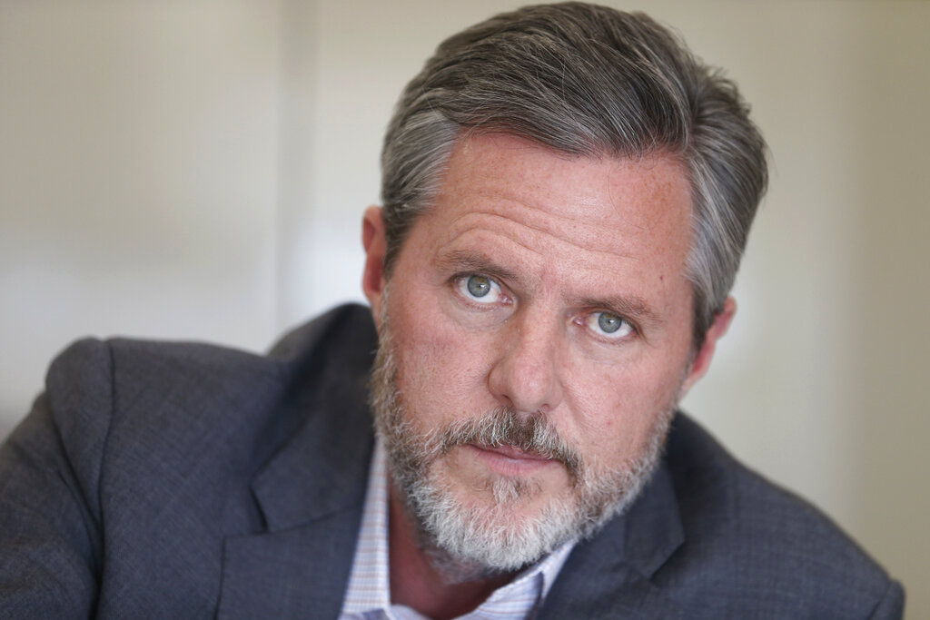 Former Liberty University president Jerry Falwell Jr., poses during an interview in his offices at the school in Lynchburg, Va. in 2016. Falwell filed a lawsuit Wednesday against Liberty University with defamation and breach of contract claims alleging the school damaged his reputation in statements after his resignation. (AP Photo/Steve Helber, File)