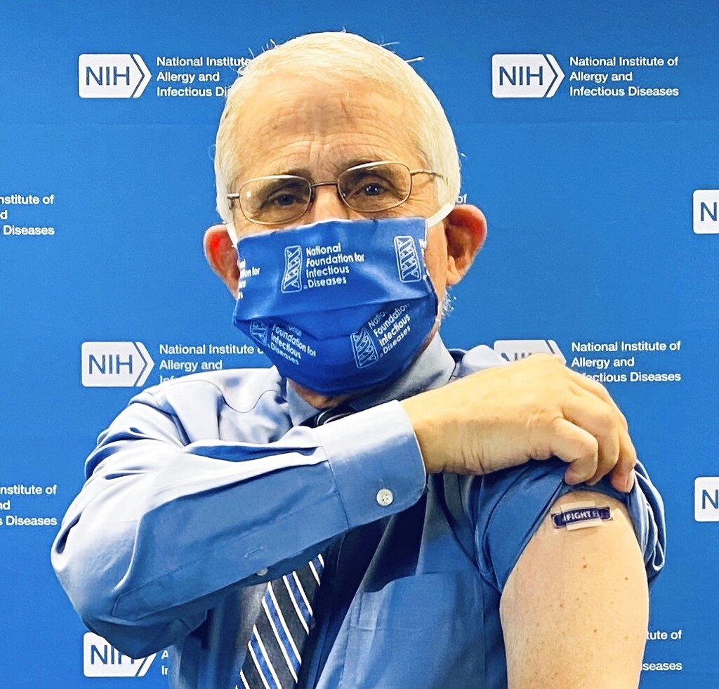 Anthony Fauci, director of the National Institute of Allergy and Infectious Diseases, National Institutes of Health, shows a bandage on his arm after receiving an influenza vaccine to kick-off the 2020-2021 flu season. (NFID via AP)