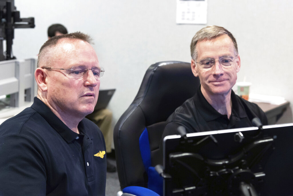 Commercial Crew Program and Boeing Crew Flight Test astronauts Butch Wilmore, left, and Chris Ferguson participate in a flight control simulation for a Boeing CST-100 Starliner capsule at the Johnson Space Center in Houston in 2018. On Wednesday, Ferguson removed himself from the first Starliner crew, citing his daughter's wedding in 2021. He has been replaced on the crew by Wilmore. (James Blair/NASA via AP)