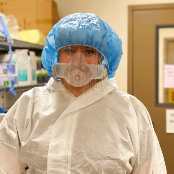 Nurse Amelia Montgomery poses for a photo at Cox South Hospital in Springfield, Mo., in September. Treating the sick and dying isn't even the toughest part for Montgomery as the coronavirus surges in her corner of red America. She says it's dealing with patients and relatives who don't believe the virus is real. (Kaitlyn McConnell/CoxHealth via AP)