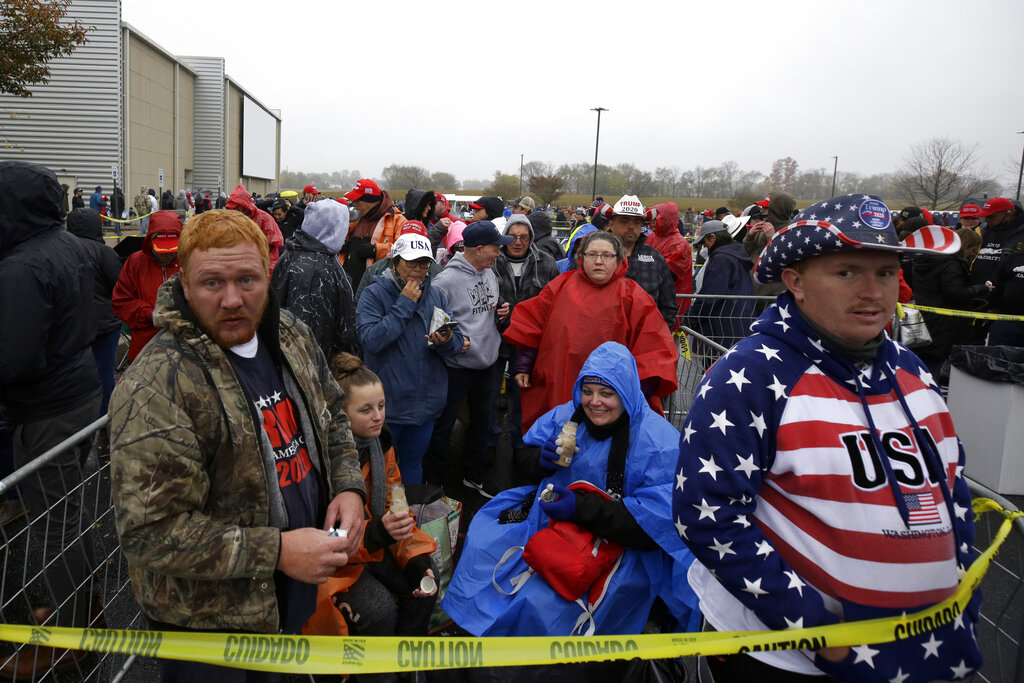 Kyle Terry, 33, front left, stands at the head of the line of supporters waiting to attend a campaign rally for President Donald Trump at Lancaster Airport on Monday in Lititz, Pa. Cynthia Reidler is seen in background. (AP Photo/Jacqueline Larma)