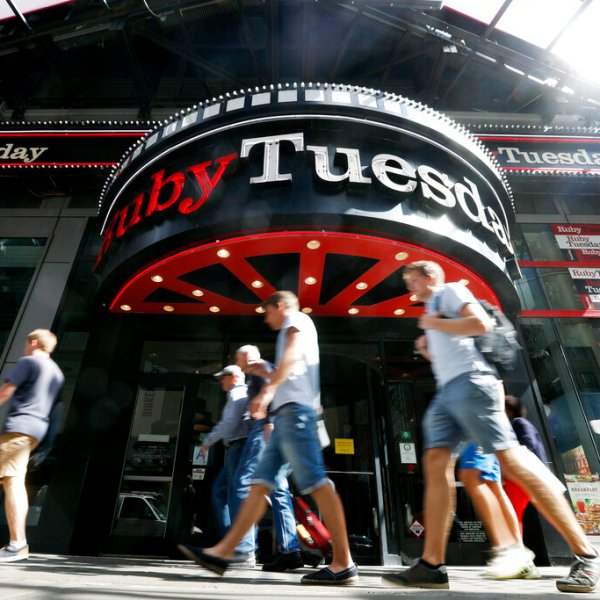 Visitors to New York's Times square walk past a Ruby Tuesday restaurant in 2016. Ruby Tuesday is filing for bankruptcy protection, the latest casual chain to suffer from coronavirus-related closures and changing consumer habits. The Maryville, Tennessee-based company says its restaurants will remain open throughout the bankruptcy process. (AP Photo/Mary Altaffer, File)
