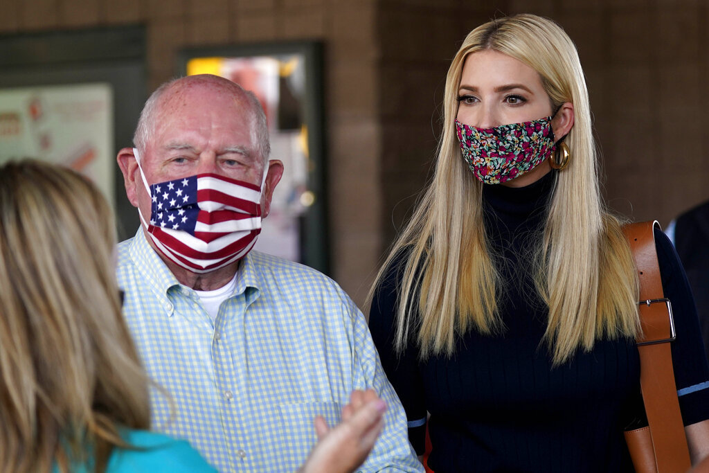 Ivanka Trump, right, and Secretary of Agriculture Sonny Perdue, left, speak with a farming family during a visit to the North Carolina State Farmers Market in Raleigh, N.C., in September.. (AP Photo/Gerry Broome)