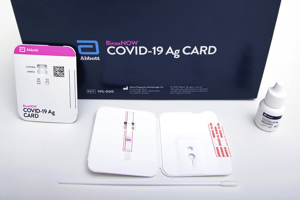 This image provided by Abbott Laboratories shows the company's BinaxNOW rapid COVID-19 nasal swab test. After months of struggling to ramp up coronavirus testing, the U.S. is now capable of testing some 3 million people daily thanks to a growing supply of rapid tests. But the testing boom comes with a new challenge: keeping track of the results. (Abbott Laboratories via AP)