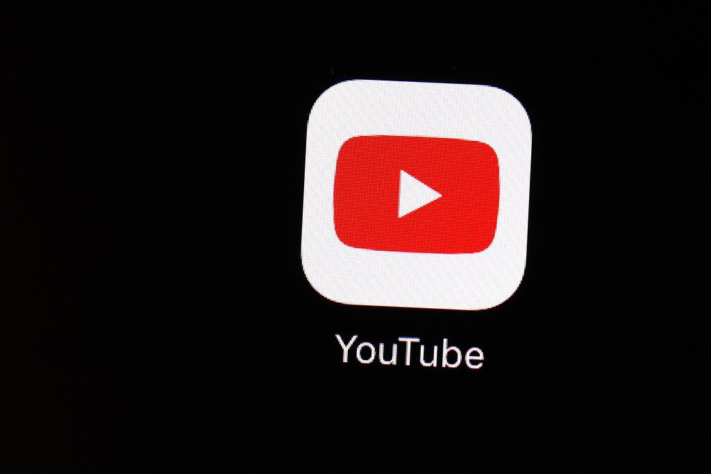 YouTube is following the lead of Twitter and Facebook, saying that it is taking more steps to limit QAnon and other baseless conspiracy theories that can lead to real-world violence. The Google-owned video platform said Thursday it will now prohibit material targeting a person or group with conspiracy theories that have been used to justify violence. (AP Photo/Patrick Semansky, File)