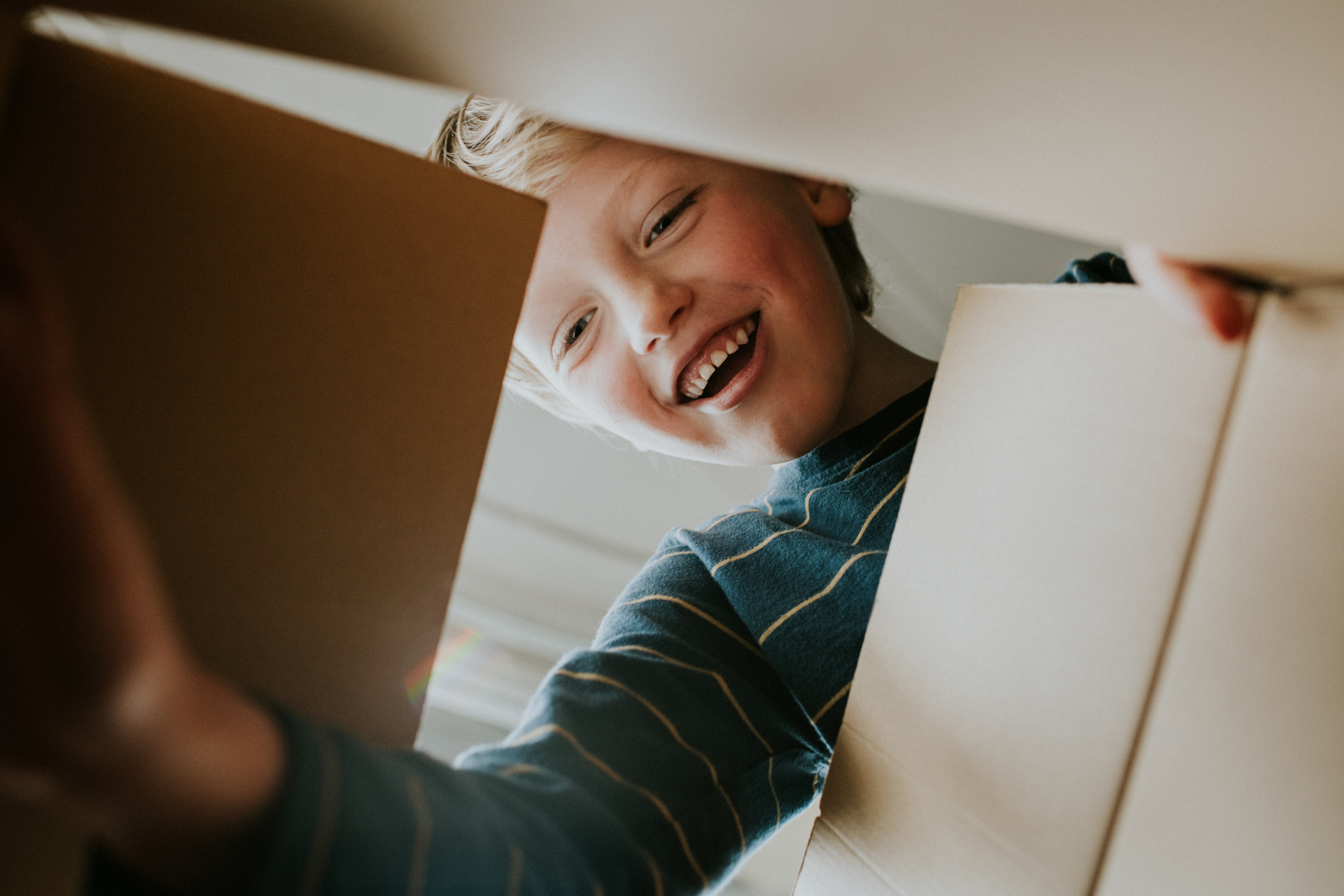 Boy looking into box