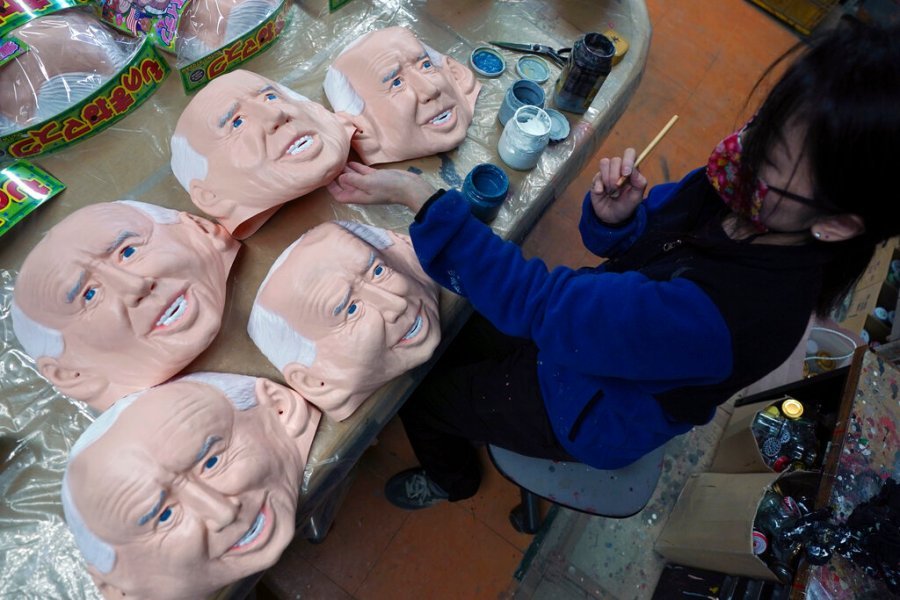 An employee adds details to rubber masks depicting President-elect Joe Biden at the Ogawa Studios in Saitama, north of Tokyo. (AP Photo/Eugene Hoshiko)