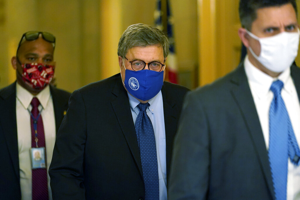 Attorney General William Barr leaves the office of Senate Majority Leader Mitch McConnell of Ky., on Capitol Hill in Washington, Monday, Nov. 9, 2020. (AP Photo/Susan Walsh)