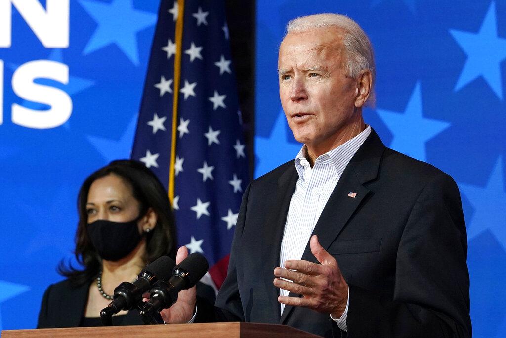Democratic presidential candidate Joe Biden speaks Thursday in Wilmington, Del. with Sen. Kamala Harris. (AP Photo/Carolyn Kaster)