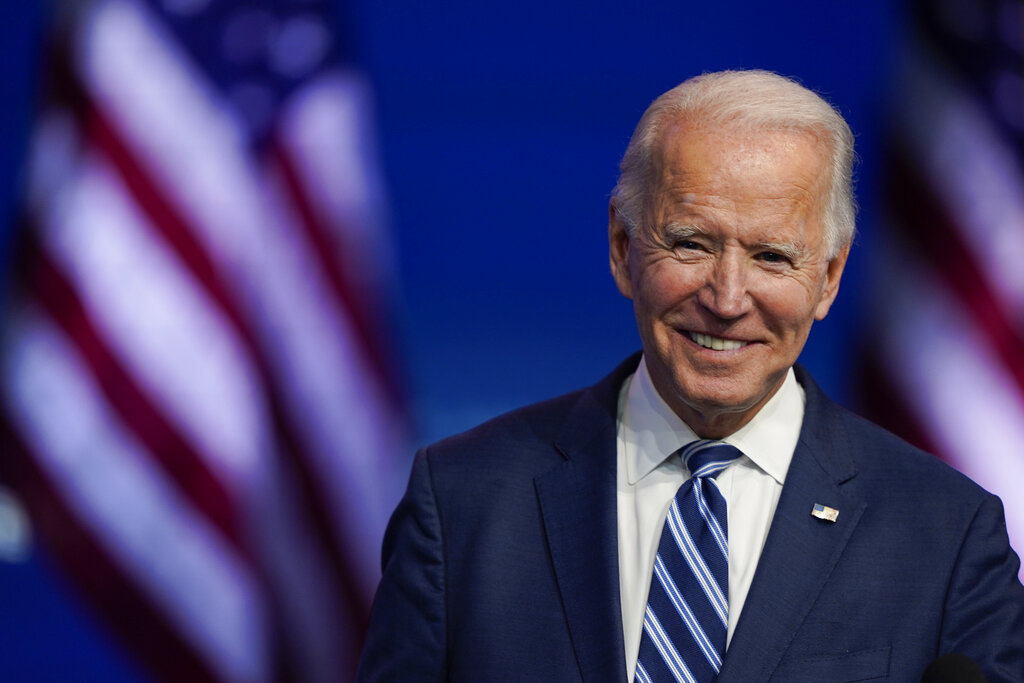 President-elect Joe Biden smiles as he speaks at The Queen theater in Wilmington, Del. President-elect Biden turns 78 on Friday, Nov. 20. (AP Photo/Carolyn Kaster, File)