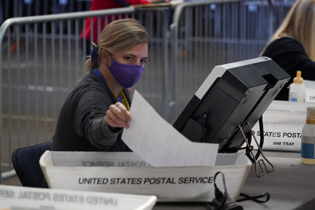 Ballots are counted at the Allegheny County Election Division warehouse on the Northside of Pittsburgh, Friday, Nov. 6, 2020. (AP Photo/Gene J. Puskar)
