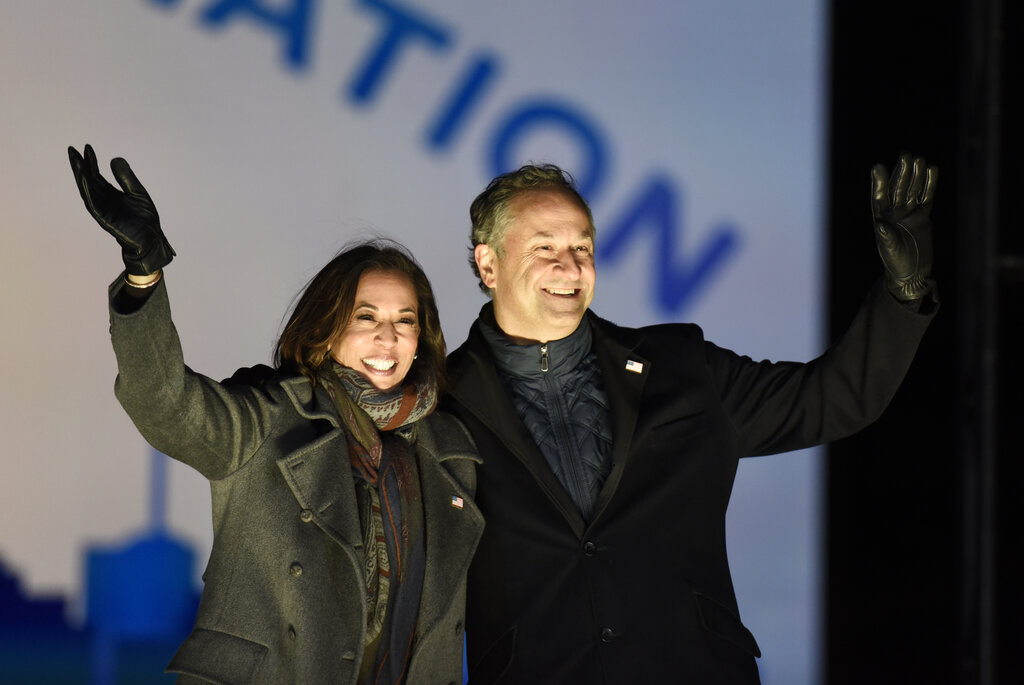 Kamala Harris and husband Doug Emhoff take the stage during a drive-in get out the vote rally, Monday, Nov. 2, 2020, in Philadelphia. (AP Photo/Michael Perez)