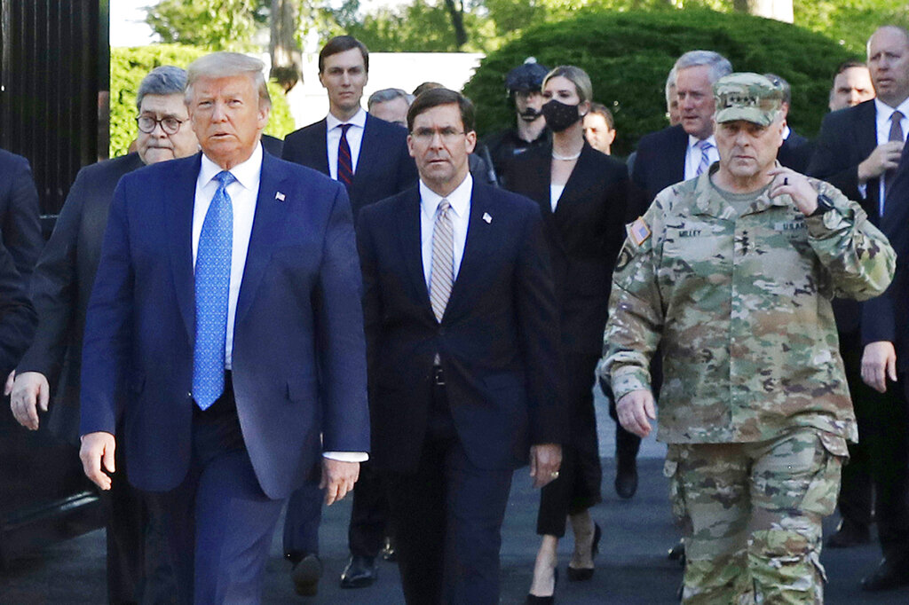 President Donald Trump departs the White House to visit outside St. John's Church in Washington on June 1. Walking behind Trump from left are, Attorney General William Barr, Secretary of Defense Mark Esper and Gen. Mark Milley, chairman of the Joint Chiefs of Staff. (AP Photo/Patrick Semansky, File)