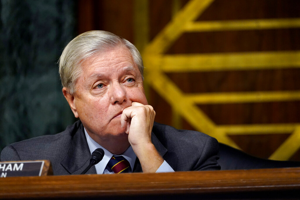 Sen. Lindsey Graham listens during a Senate Judiciary Committee hearing on Capitol Hill in Washington, Tuesday, Nov. 10, 2020, on a probe of the FBI's Russia investigation. (AP Photo/Susan Walsh, Pool)