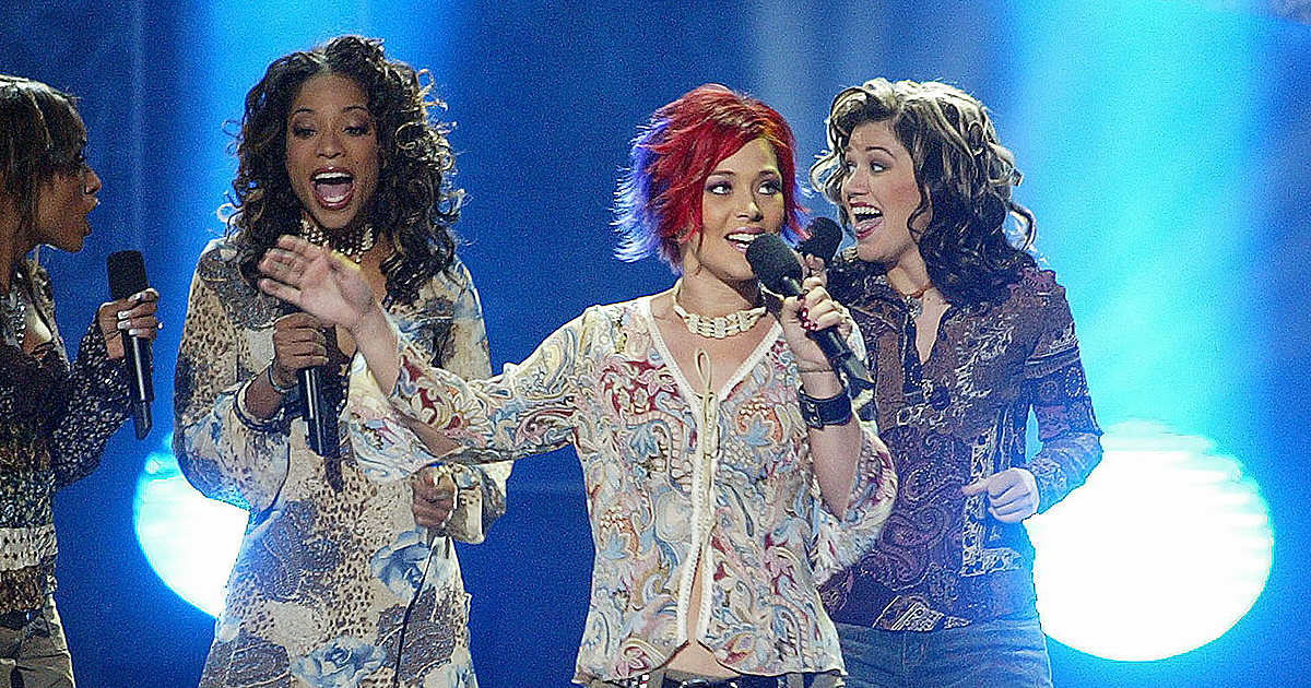 """Nikki McKibbin, center, performs on the """"American Idol"""" finale in 2002. (Kevin Winter/ImageDirect)"""