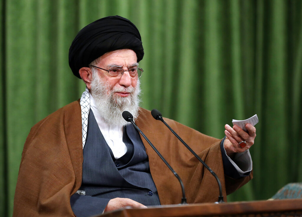Supreme Leader Ayatollah Ali Khamenei addresses Iran in a televised speech marking the birthday of Islam's Prophet Muhammad, on Tuesday. In his remarks, Khamenei quoted President Donald Trump's own baseless claims about voter fraud to criticize the vote as Tehran marked the 1979 U.S. Embassy hostage crisis. (Office of the Iranian Supreme Leader via AP)