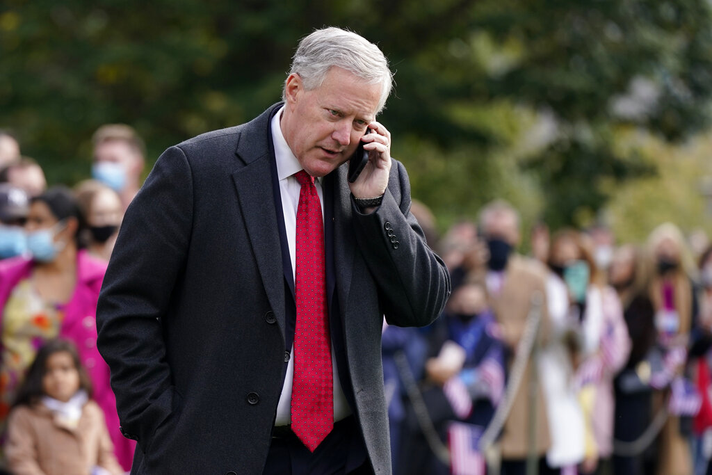 White House chief of staff Mark Meadows speaks on a phone on the South Lawn of the White House on October 30.. Meadows has been diagnosed with the coronavirus as the nation sets daily records for confirmed cases for the pandemic. (AP Photo/Patrick Semansky)