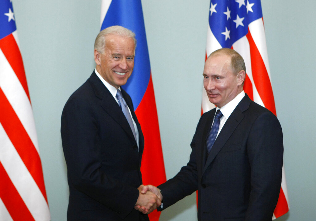 Vice President of the United States Joe Biden shakes hands with Russian Prime Minister Vladimir Putin in Moscow in 2011. Putin won't congratulate President-elect Joe Biden until legal challenges to the U.S. election are resolved and the result is official, the Kremlin announced Monday. (AP Photo/Alexander Zemlianichenko, File)