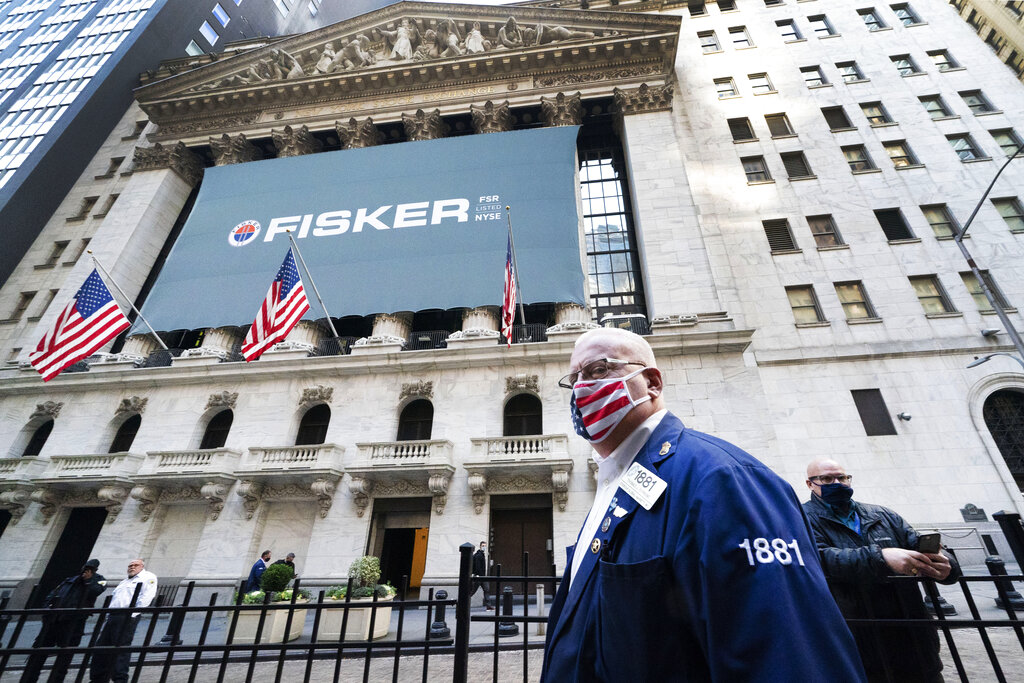 Stock trader Thomas Ferrigno arrives to work at the New York Stock Exchange, Monday, Nov. 9, 2020. World markets rocketed higher after Pfizer said early data show its coronavirus vaccine is effective. That added to investor relief that results from the U.S. presidential election were finally decided, with Joe Biden the president-elect. (AP Photo/Mark Lennihan)