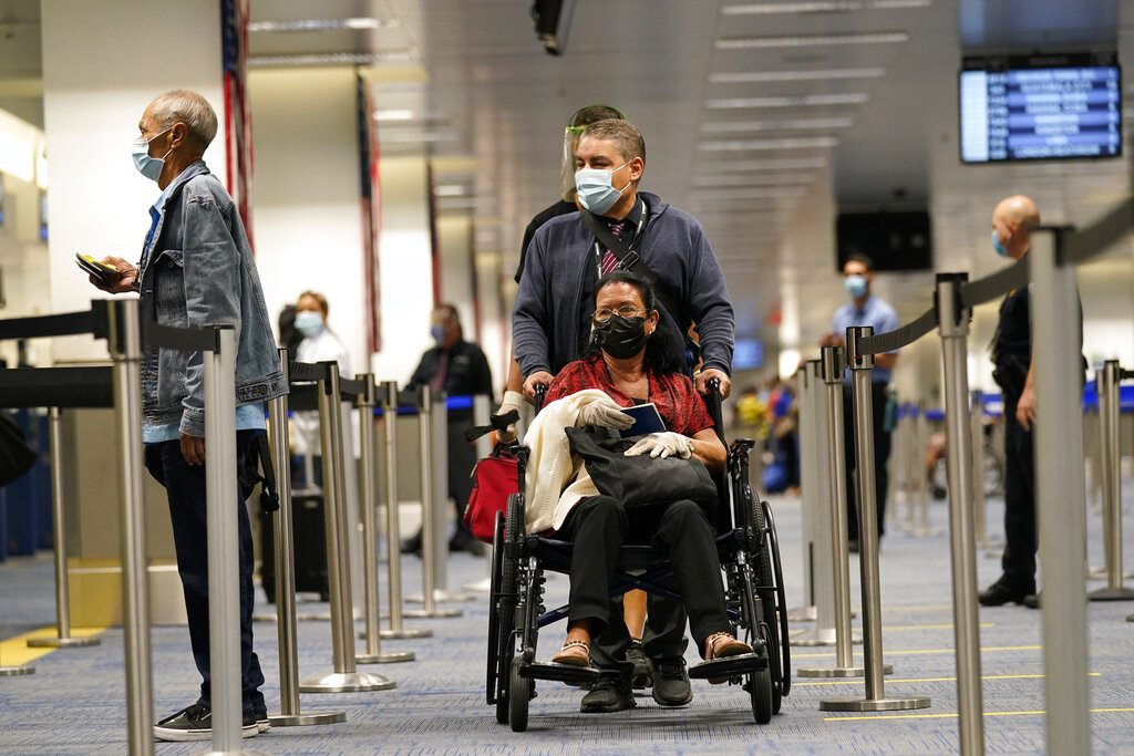 Passengers arrive at Miami international Airport where they are screened by U.S. Customs and Border Protection. (AP Photo/Lynne Sladky)